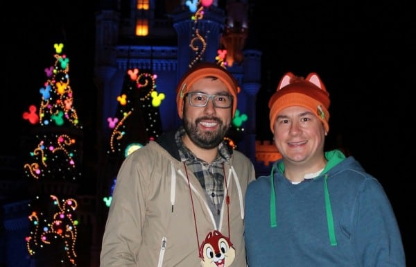 A passerby snaps a photo of Chris and I in front of Cinderella's castle on our last night in the parks.